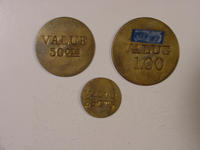 Trade Tokens, Reverse Side--One Dollar, Fifty Cents, And Twenty-Five Cents